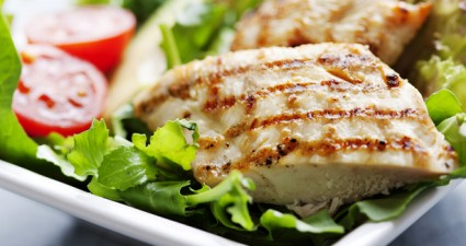 closeup of healthy salad with grilled chicken fillet, selection of lettuce,tomatoes and avocado,